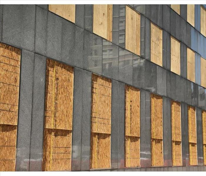 Windows and doors of a building boarded