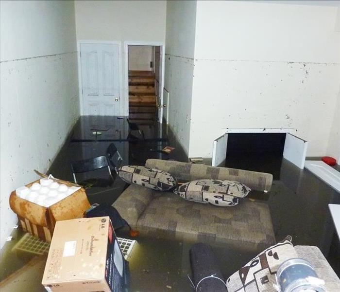 Completely flooded basement. A visible line is showing maximum water level higher than 7 feet.